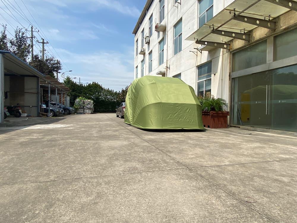 green car garage 2021 side front